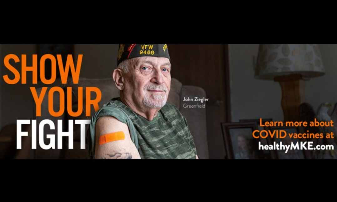 VFW member with COVID vaccine Band-Aid on arm