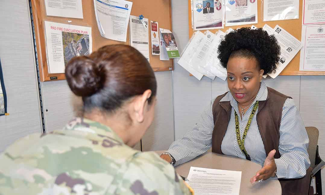 Service member meets with career training rep