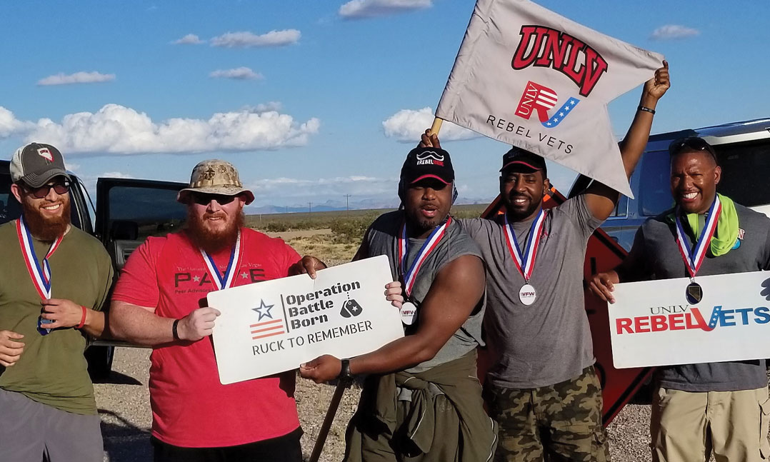 Student vets from the University of Nevada, Las Vegas pose for a photo during the 2019 Operation Battle Born rucksack march near Tonopah, Nev. Some 36 groups of four or more people, including student veterans from Nevada, hiked 10-mile stints from Carson City, Nev., to Boulder City, Nev.
