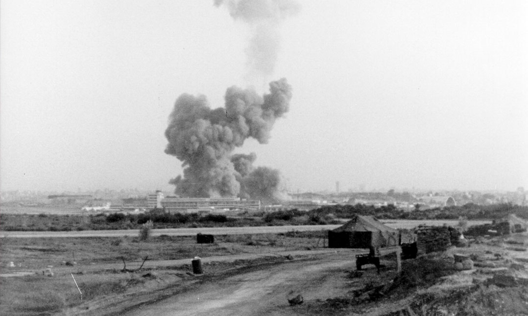 A pillar of smoke rises from the headquarters and barracks of the 1st Bn., 8th Marines, 24th Marine Amphibious Unit on Oct. 23, 1983, at the Beirut International Airport in Lebanon. This was the sight that greeted Marine helicopter crews launched from the USS Iwo Jima (LPH-2) as they flew to aid the wounded.