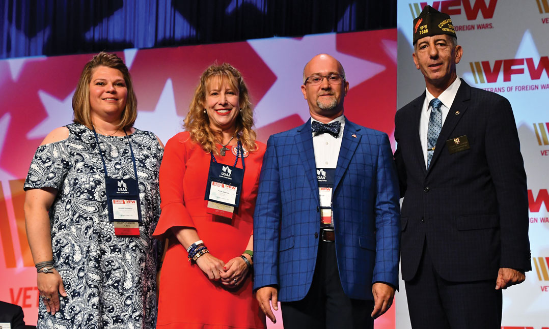 From left to right, Bobbie Schamens, Anne Martin, and Kevin Allen Wagner, celebrate their Teacher of the Year recognition alongside then-VFW Commander-in-Chief B.J. Lawrence, far right, in July at the VFW National Convention in Orlando, Fla.