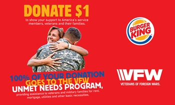 Soldier hugs his wife Burger King raises money for VFW