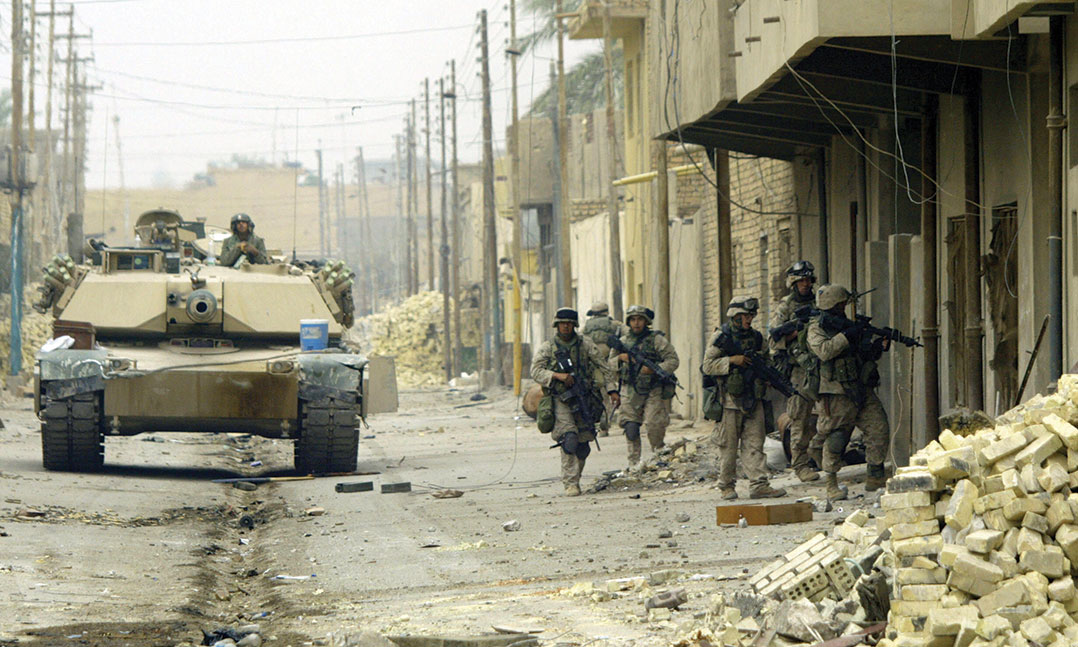 Marines of Kilo Company, 3rd Battalion, 5th Marines, conduct a house-to-house search in Fallujah on Nov. 17, 2004