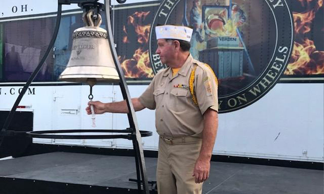 VFW member strikes the new Mayflower II bell during a ceremony