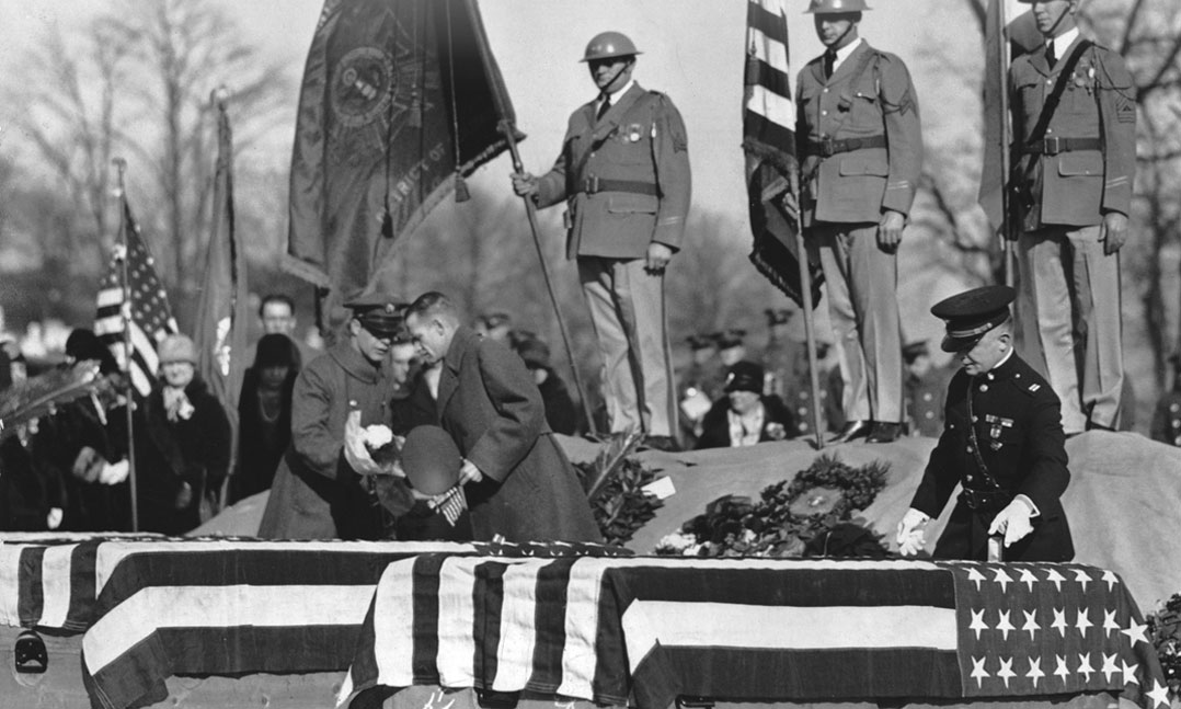 "VFW Department of Washington, D.C. Commander Harvey Miller places Crosses of Malta on caskets of three ""Polar Bears"" after their remains returned stateside in November 1929 at Arlington National Cemetery"