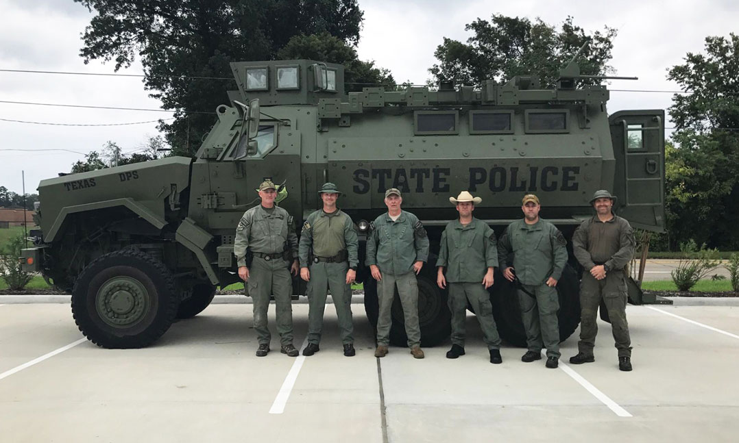 Six members of the Texas State Patrol prepare for Hurricane Harvey relief efforts