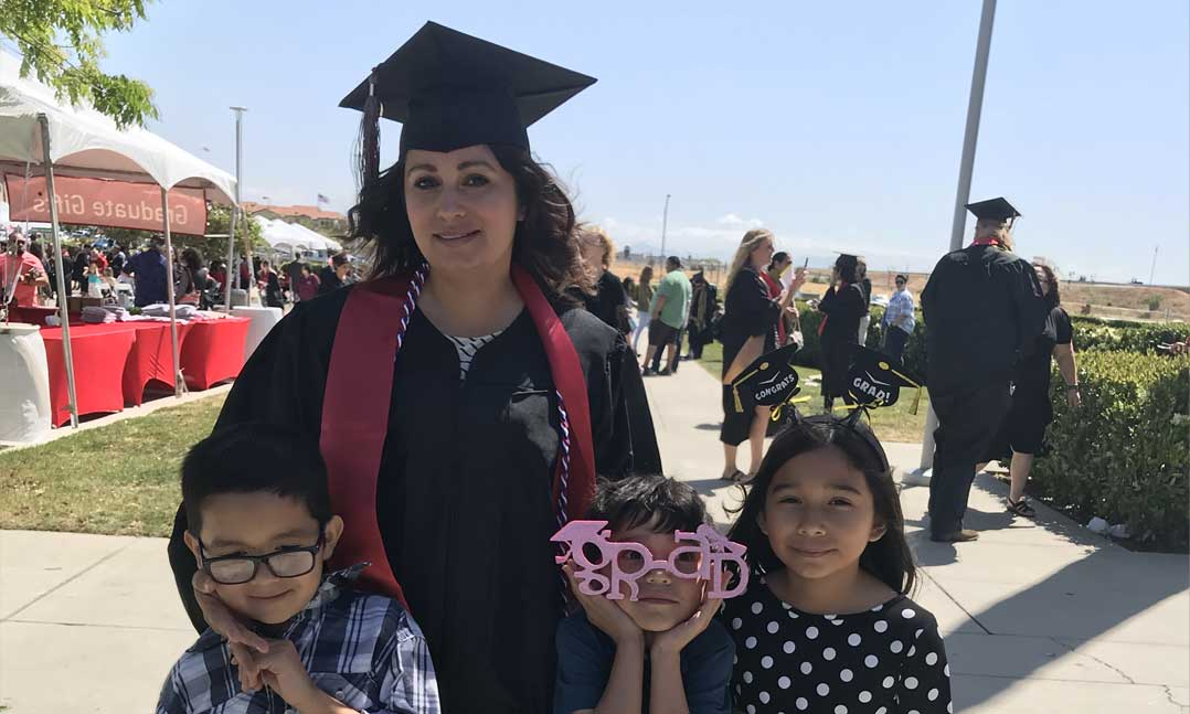 Female student veteran graduate with her children