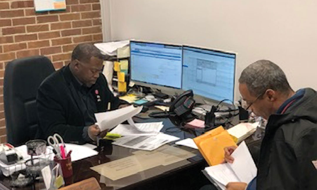 Reginald Sims, an accredited VFW service officer in Jackson, Tenn., helps a veteran apply for benefits. Sims is a life member of VFW Post 6496 in Jackson.