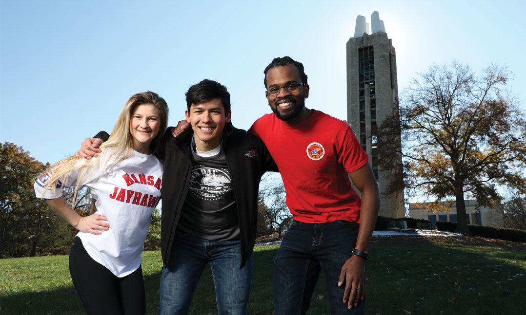 University of Kansas Student Veterans of America Chapter Vice President of Media Kylie Coffelt, Vice President of Finance Mike Ellis and President Omar Williams hang out on campus in front of the Campanile, a WWII memorial, in November in Lawrence, Kan. SVA chapters across the country advocate for improvements to benefits for the more than 700,000 student veterans on its campuses.