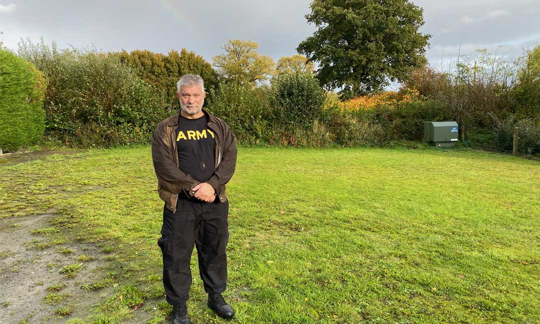 Veteran standing in a field in France