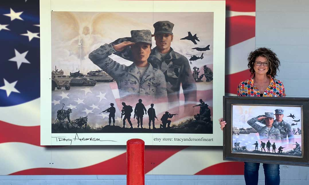 Artist Tracy Anderson stands next to the 12-foot-by-8-foot mural she painted on VFW Post 936 in Alexandria, Minnesota