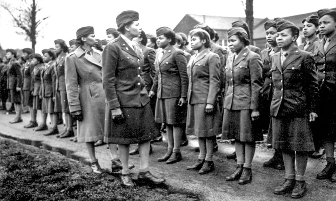Women's Army Corps 6888th Central Postal Directory Battalion standing at attention prior to their deployment to Europe during World War II