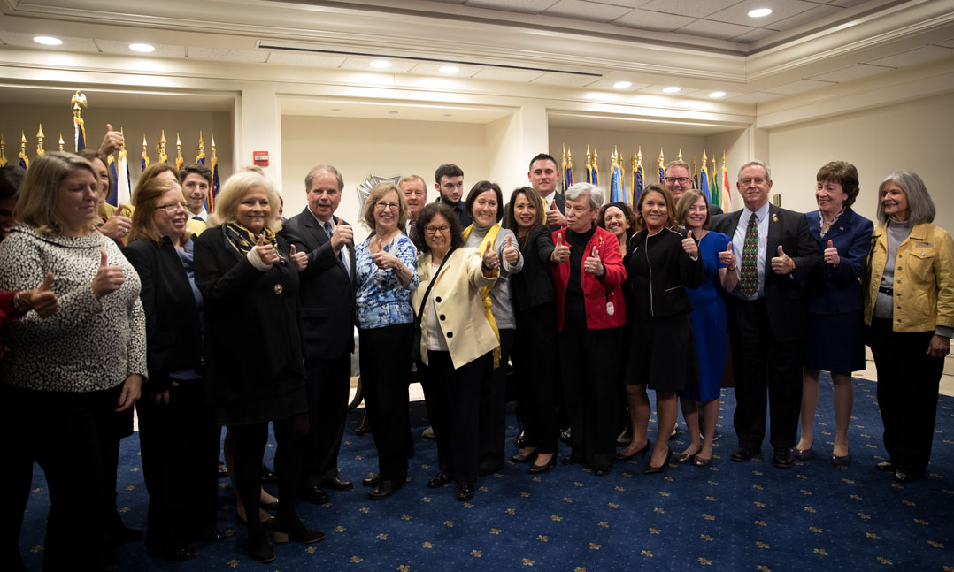 Veterans, congressional leaders and spouses impacted by the widow's tax celebrate the passing of the National Defense Authorization Act of 2020 on Dec. 20 at the VFW Washington Office on Capitol Hill.