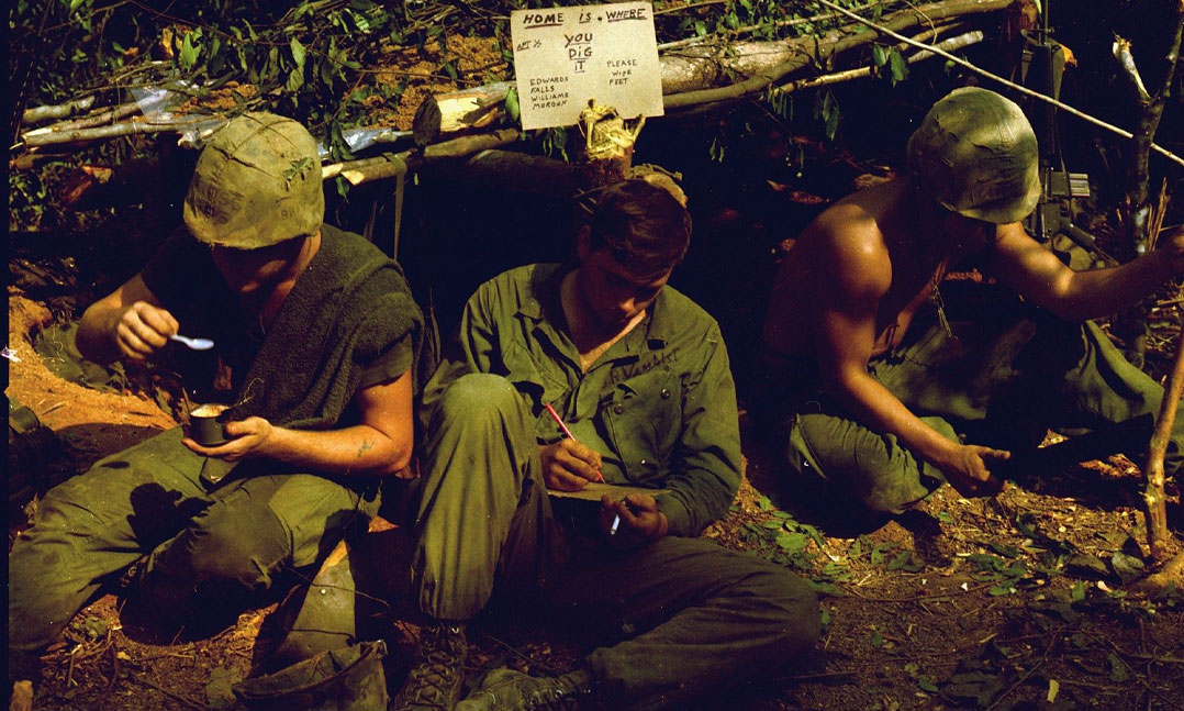 soldiers in front of their foxhole during the Vietnam War
