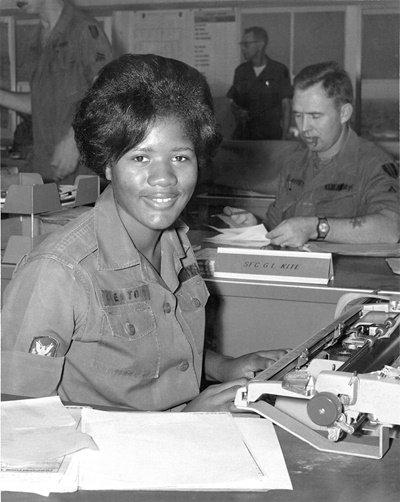 Member of the Women's Army Corps types correspondence during the Vietnam War