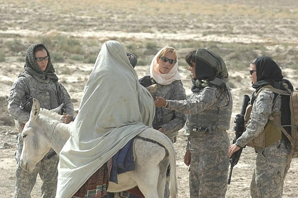 Women service members prepare to search a woman on a donkey in Afghanistan's Zabul province