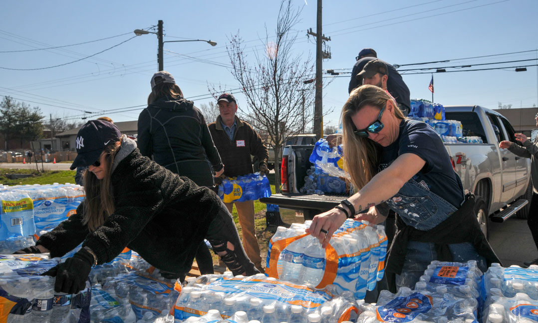 Volunteers at VFW Post 1970 in West Nashville, Tenn., load bottles of water onto a pickup to donate to victims affected by the March 3 tornado that struck the Nashville area