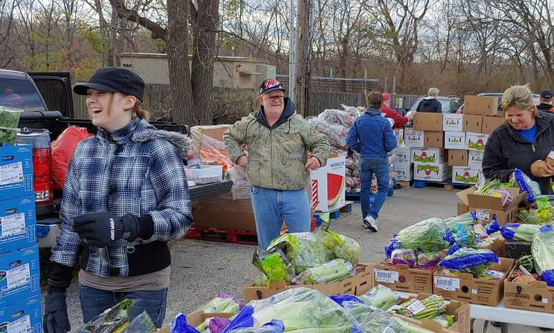 VFW and Auxiliary members gather donated food for veterans and their local communities
