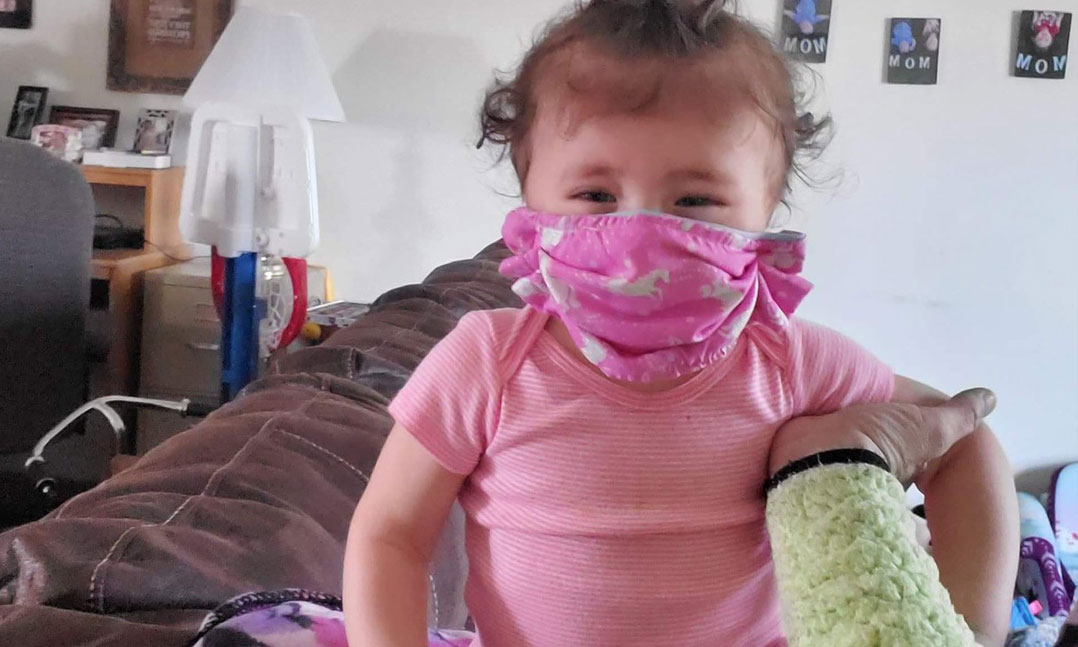 Baby wearing a VFW-made face mask during the COVID-19 pandemic of 2020
