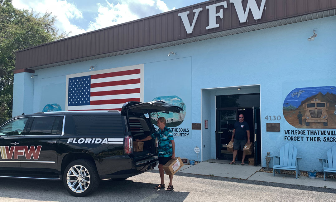 VFW members load up supplies for veterans and people during the COVID-19 pandemic